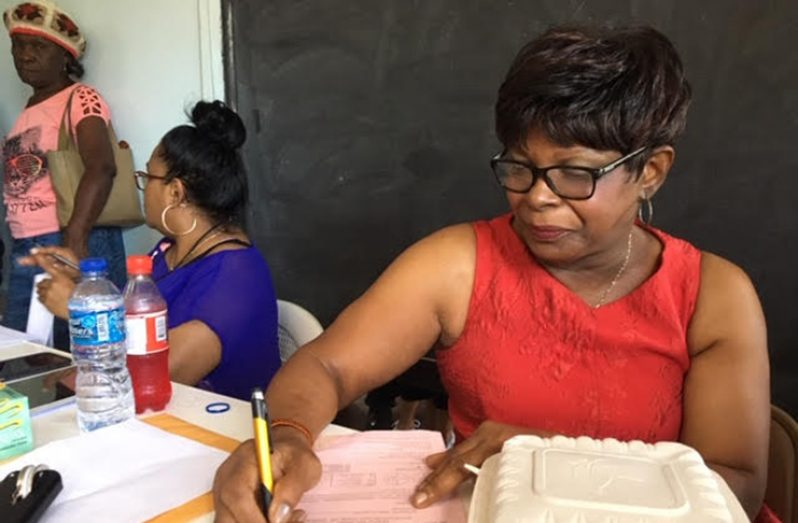 New York-based Guyanese, Lorna Welchman-Neblett, at work at the Cancer Out-Reach at Herstelling, East Bank Demerara (Photo by F.Q. Farrier)