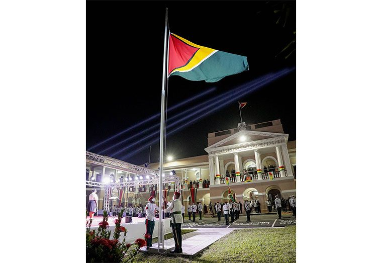 Patriotism soared as the Golden Arrowhead was hoisted on the eve of Guyana's 51st Republic Anniversary. The flag-raising ceremony, accompanied by a cultural programme, was hosted at the Parliament Buildings on Brickdam, Georgetown, in the presence of members of the Government and the Diplomatic Corps (Latchman Singh photo)