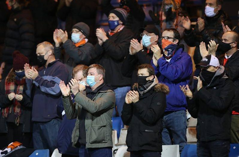 Fans must wear masks at EPL games, as Luton and Norwich supporters did at their Championship match.