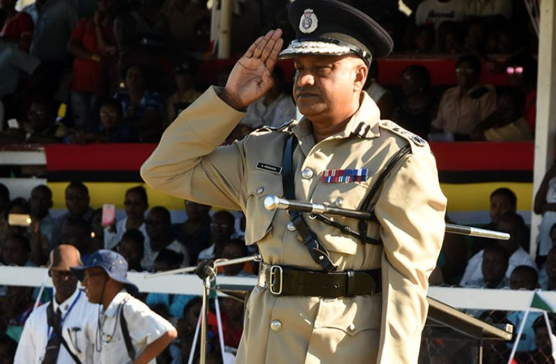 Outgoing Police Commissioner Seelall Persaud salutes Wednesday during his farewell parade at the Police Sports Club Ground, Eve Leary (Adrian Narine photo)