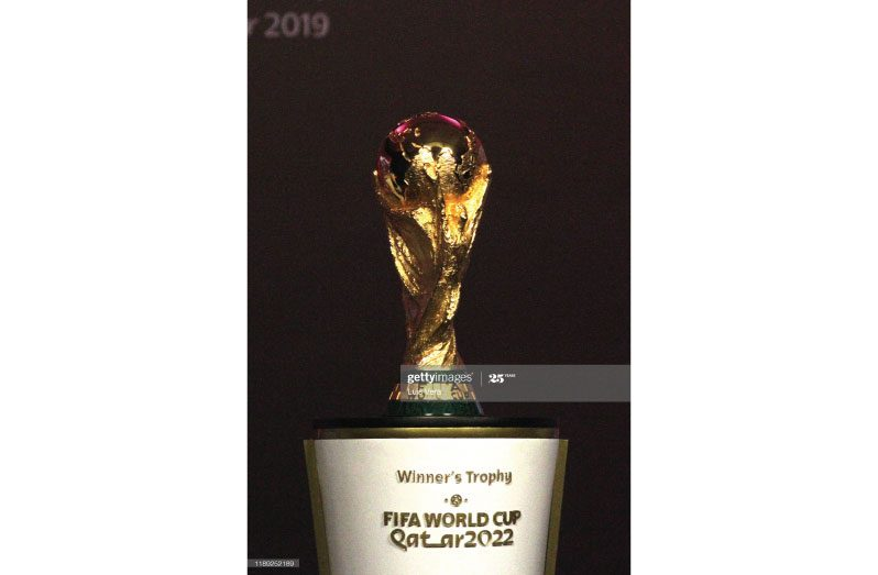 The FIFA World Cup trophy is displayed during the draw of the South American Qualifiers for Qatar 2022 at Centro de Convenciones de CONMEBOL on December 17, 2019 in Asuncion, Paraguay. (Photo by Luis Vera/Getty Images)