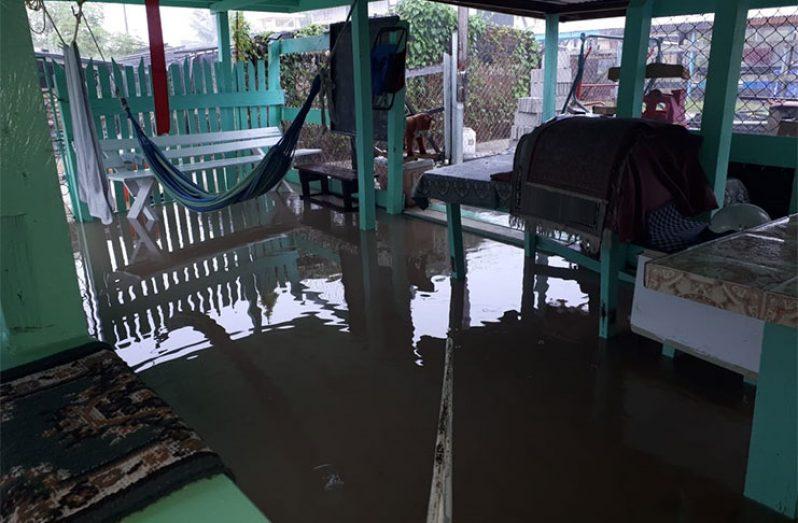 A resident's home in La Belle Alliance under water