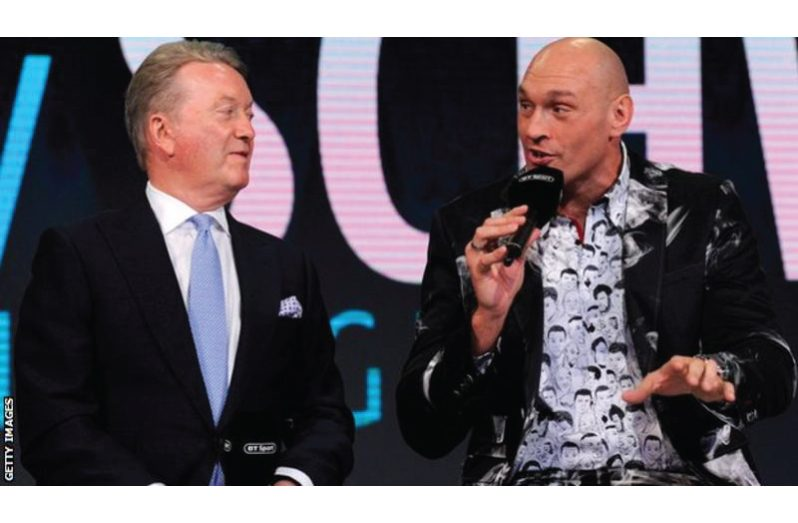 Frank Warren (left) wants to find a way for fighters like WBC heavyweight champion Tyson Fury to return to action in a viable manner.