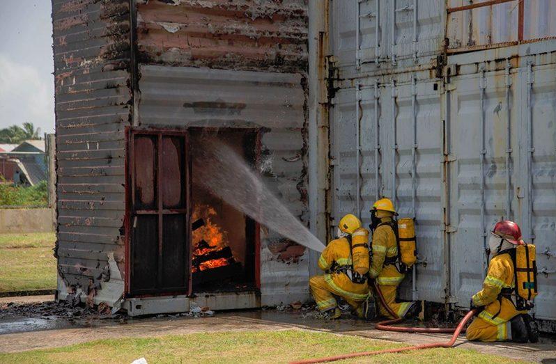 The new graduates undertaking a fire drill exercise (Marceano Narine/DPI photo)
