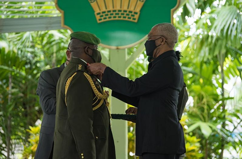 President David Granger affixes new Badge of Rank on GDF Chief of Staff, Brigadier Godfrey Bess, under the Baridi Benab, State House ||Insignia Rank of Brigadier of the Guyana Defence Force