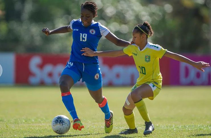 Guyana's Kiana Khedoo (#10), battling Haiti's Maudeline Moryl during their quarter-finals at the CONCACAF U-20 Women's Championship. (Photo compliments of CONCACAF)