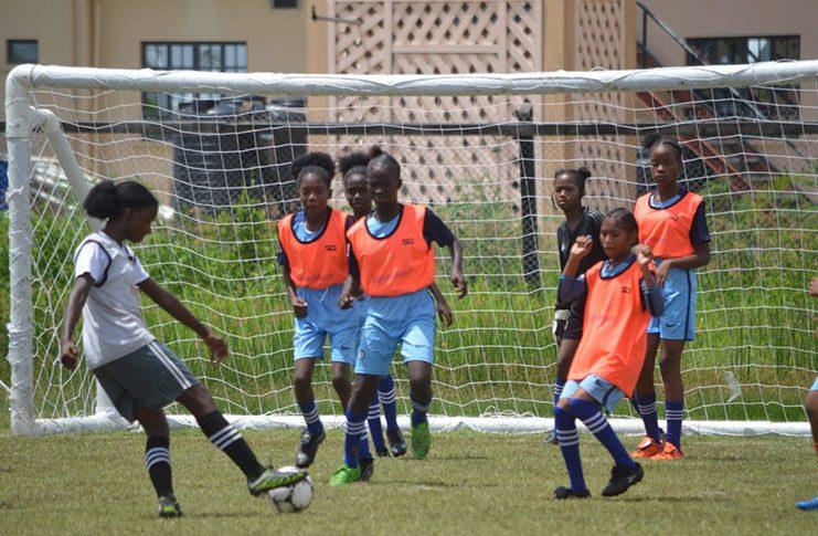 Female action in the ExxonMobil U-14 Schools Football tournament. (Adrian Narine photo)