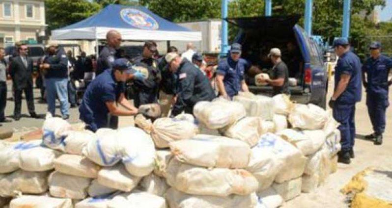 Coast Guard officials show the seized ganja