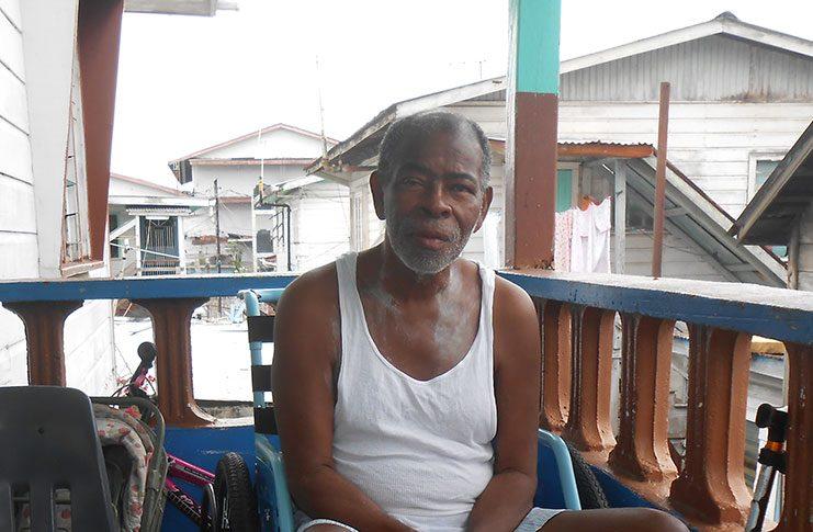 Godfrey Yhap relaxing on his veranda