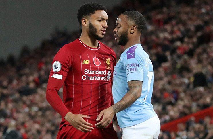 Liverpool's Joe Gomez and Manchester City's Raheem Sterling clash Action Images via Reuters/Carl Recine