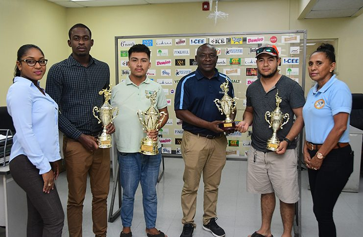 The winners stand with organisers and Banks DIH PRO Troy Peters. (Adrian Narine photo)