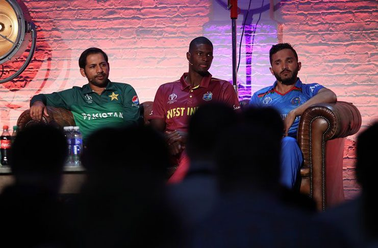 West Indies captain Jason Holder (centre) is flanked by Pakistan's Sarfaraz Ahmed and Afghanistan's Gulbadin Naib, as he speaks during an ICC captains media day, yesterday. (Photo courtesy ICC Media)