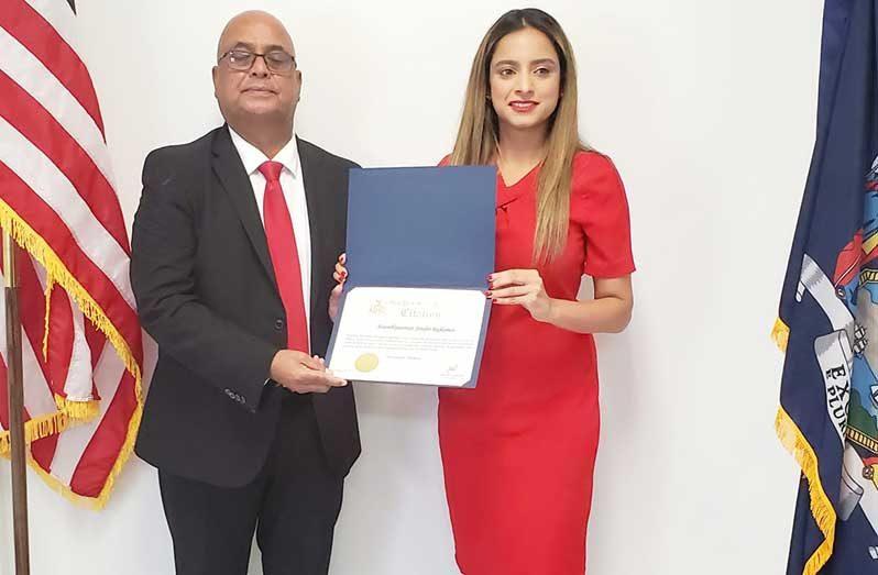 President of Guyana Oil and Gas Energy Chamber, Manniram Prashad, receives the citation from New York State Assemblywoman, Jenifer Rajkumar