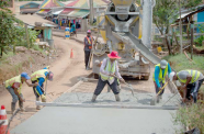 Workers compacting concrete just beyond Port Kaituma Police Station back in 2019 (DPI photo)