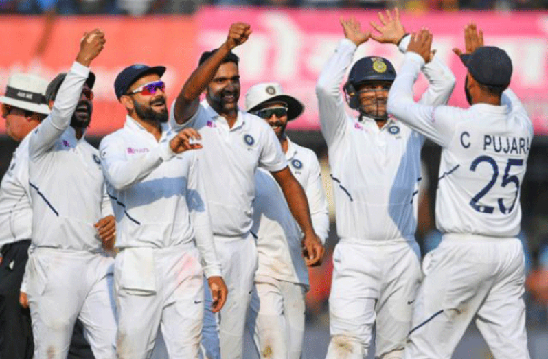 India celebrate the dismissal of Bangladesh's Mushfiqur Rahim on their way to a crushing victory in the first Test in Indore (AFP Photo/Indranil MUKHERJEE)