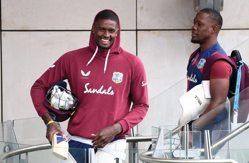Jason Holder and Nkrumah Bonner head to the nets, Old Trafford, yesterday.
