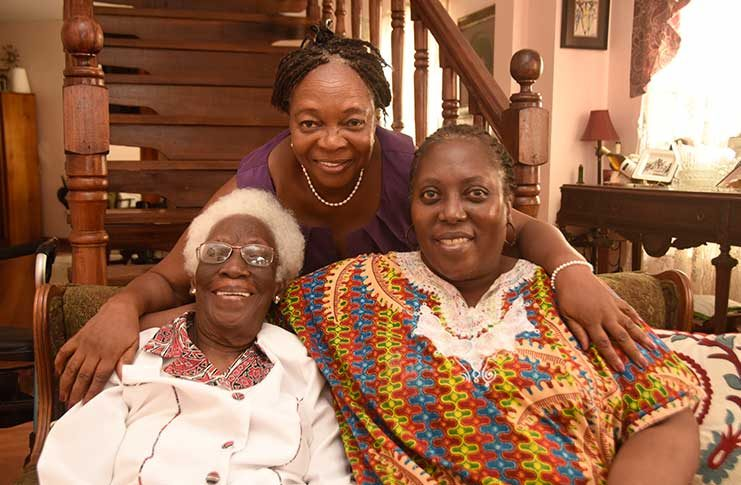 102-year-old Jean Smith, her daughter who is visiting Guyana with her, Joy Okuefuna (seated at right) and a family friend, Jem Young