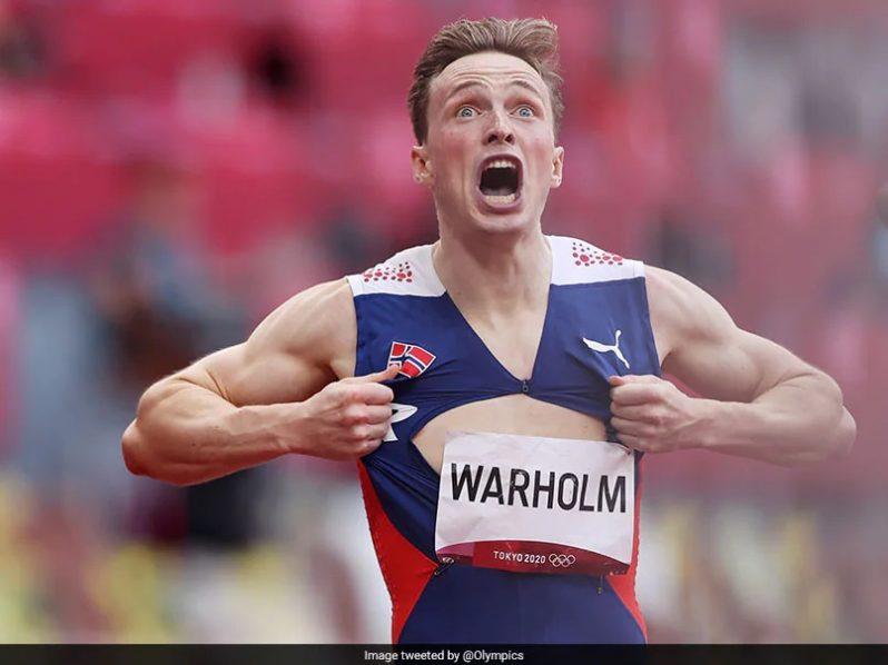 Karsten Warholm of Norway wins the men's 400-metre hurdles, setting a world record.