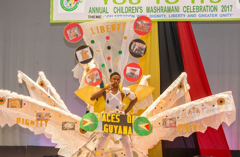 South Ruimveldt Secondary's Rashidi Ceres showcasing 'Frolic Harmony' with faces of Guyana, designed by Quacy Welcome (Samuel Maughn photo)