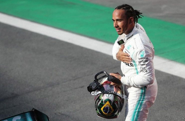 Mercedes' Lewis Hamilton celebrates after finishing in third place in qualifying. (REUTERS/Amanda Perobelli/Pool)
