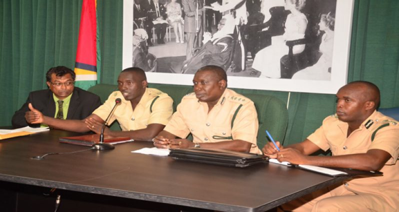 Minister of Public Security, Khemraj Ramjattan is flanked by Officer in charge of the Georgetown Prisons, Senior Superintendent Kevin Pilgrim , Director of Prisons ,Carl Graham and Deputy Director of Prisons, Acting Senior Superintendent Gladwin Samuels at yesterday's press conference.