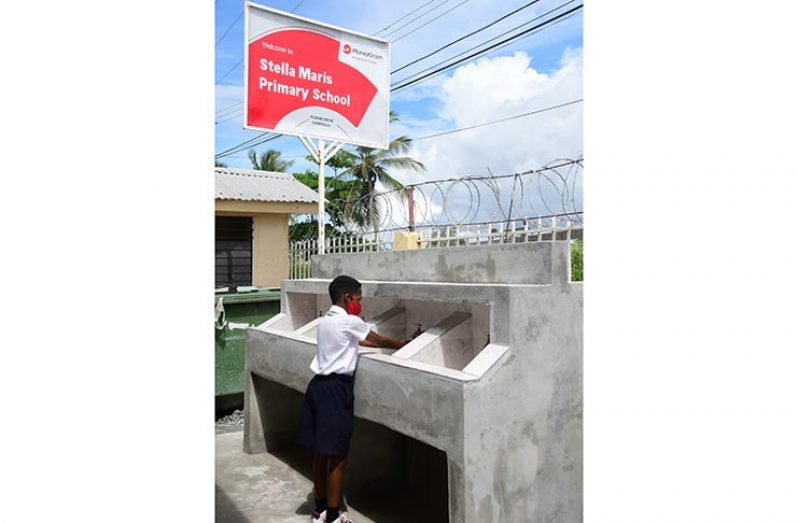 A Stella Maris Primary School pupil utilising the newly-built handwashing area