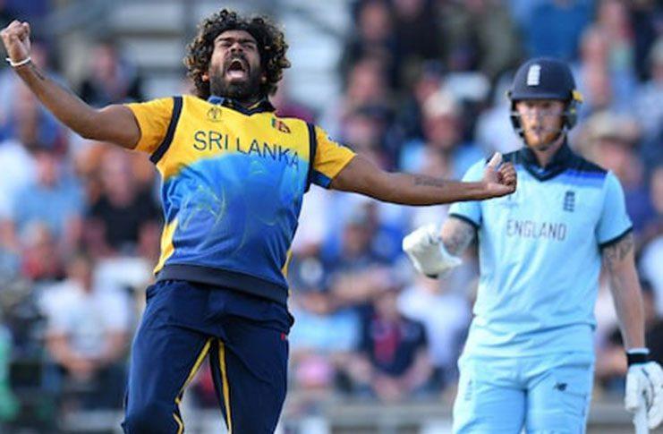 Sri Lanka's Lasith Malinga celebrates taking the wicket of England's Jos Buttler...