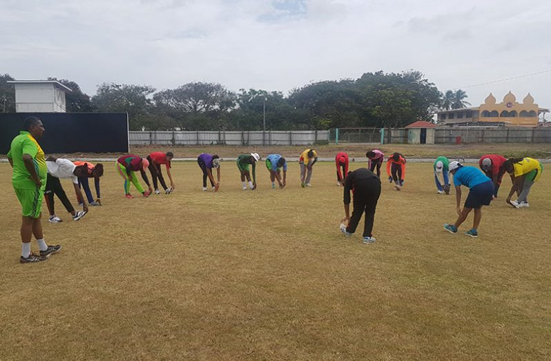 Coach Bharat Mangru looks on as the National female senior cricketers go through their paces during training session yesterday.