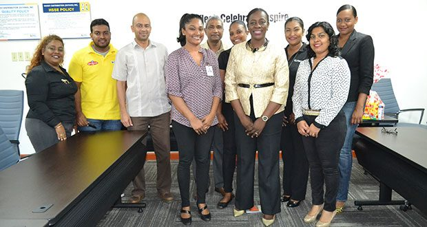 Minister Henry and staff of Massy