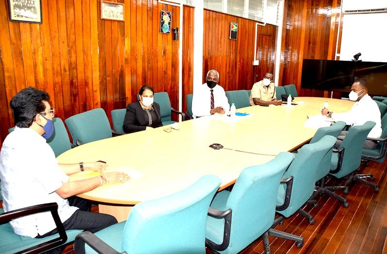 Attorney-General, Anil Nandlall, in discussion with Commissioner of Police (ag), Nigel Hoppie; Crime Chief, Wendell Blanhum; Head of the Financial Intelligence Unit, Matthew Langevine; Head of the Securities Council, Cheryl Ibbot and Central Bank Governor, Dr Gobind Ganga who joined the meeting virtually