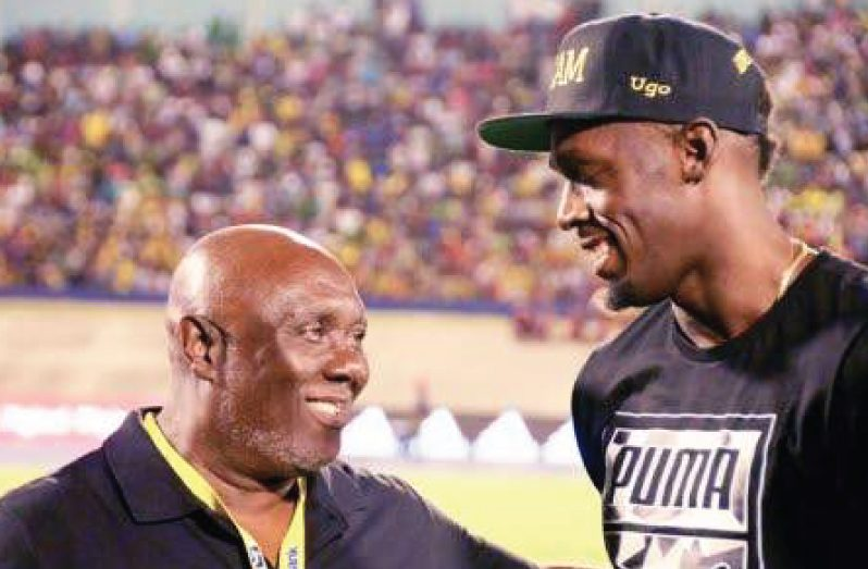 Usain Bolt (right) wih coach Glen Mills (Photo: Joseph Wellington