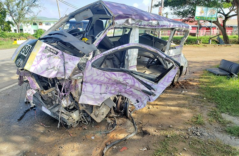 The mangled minibus on the Fairfield, Mahaicony Public Road following an accident which claimed the lives of five persons in December 2019