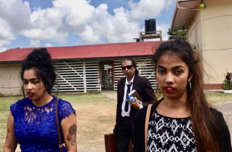 "Hemwattie ""Mona"" Singh and Yashmanie ""Tina"" Ramsew with their attorney Saphier Husain in the background."