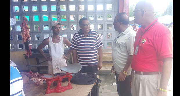 Region Six REO, Dr Veerasammy Ramayya, and the PM's Region 6 Representative, Gobin Harbhajan (right), listened to a concerned vendor during their visit to the market yesterday