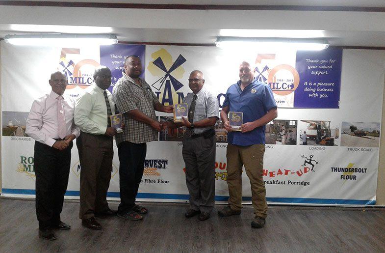 RHTYSC Secretary/CEO Hilbert Foster receives the donation from NAMILCO Managing Director, Bert Sukhai.