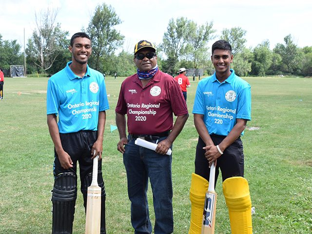 Matthew Nandu (right) with Cricket Ontario Junior Coordinator, Vish Jadunauth (centre). At left is Kaieteur International B teammate Navin Nauth.