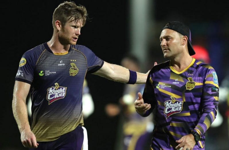 Jimmy Neesham (L) and head coach of Trinbago Knight Riders Brendon McCullum