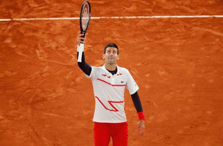 Serbia's Novak Djokovic reacts after winning his quarterfinal match against Spain's Pablo Carreno Busta at Roland Garros, Paris. (REUTERS/Gonzalo Fuentes)