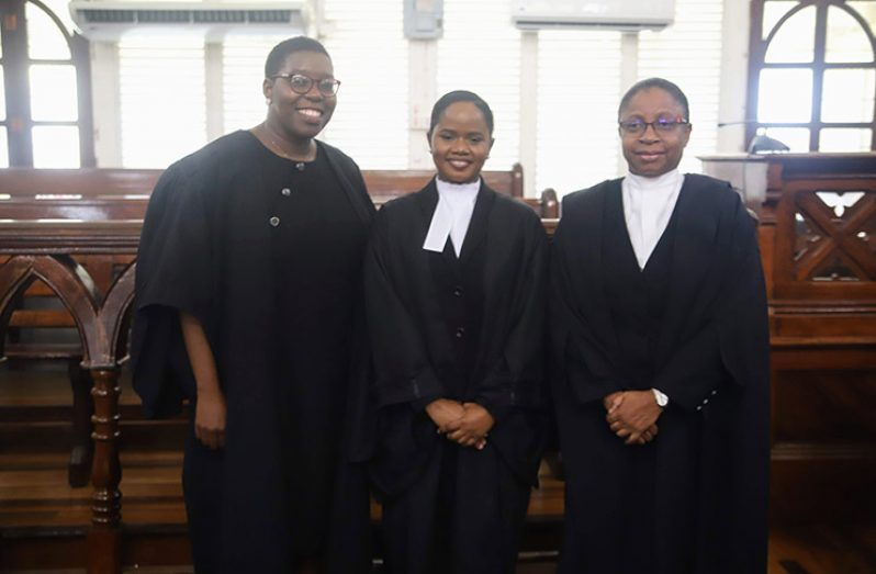 From left: Attorneys Ayana McCalman and Ocelisa Marks with Chief Justice (ag), Roxane George-Wiltshire