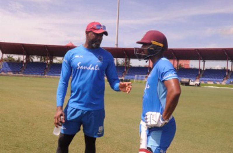 West Indies head coach Floyd Reifer (left) chats with batsman Nicholas Pooran during a training session ahead of the T20 series against India.