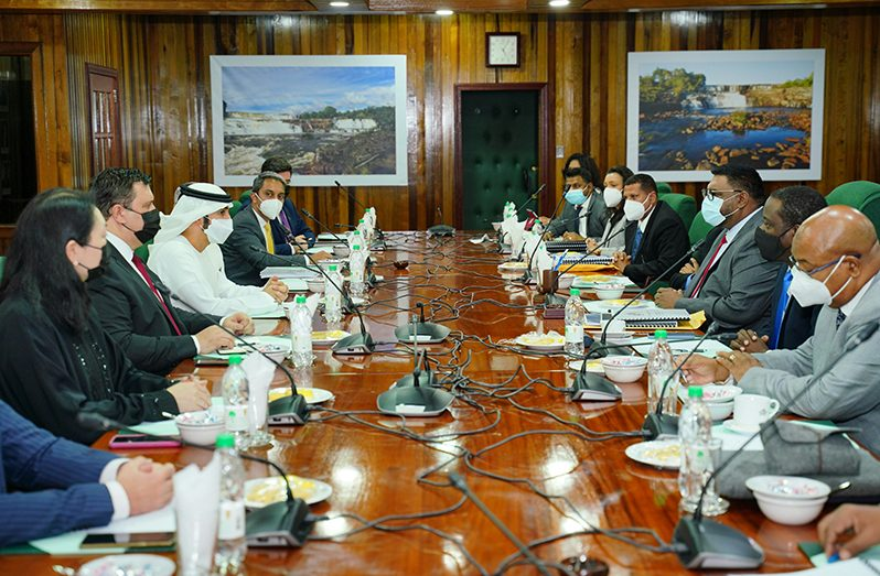 President Dr. Irfaan Ali (third right) and his team of ministers meeting with His Highness Sheikh Ahmed Dalmook Al Maktoum (fourth left) and his delegation from the UAE at the Office of the President (Office of the President photograph)