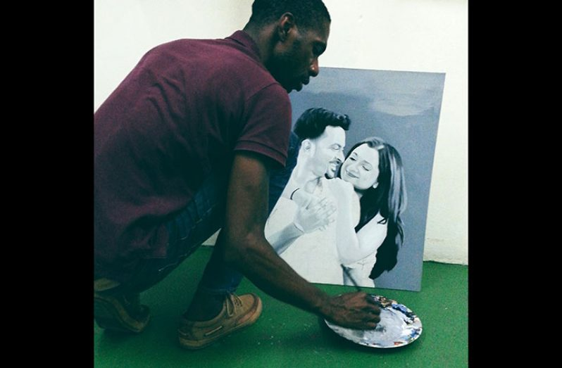 Travell Blackman hard at work on a commissioned couple's portrait