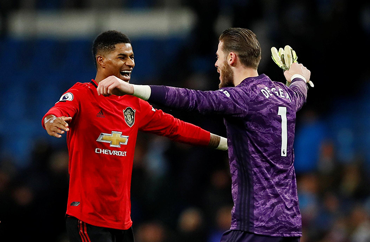 Manchester United's Marcus Rashford and David De Gea celebrate after the match yesterday v Manchester City.   (Action Images via Reuters/Jason Cairnduff)