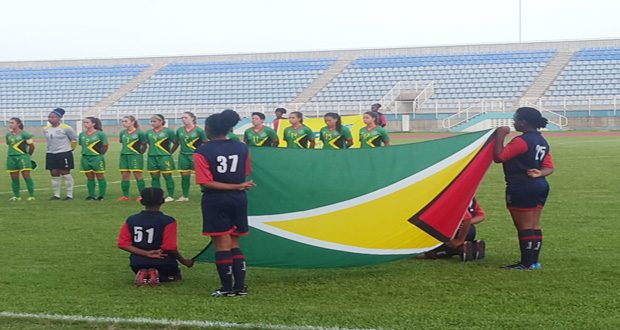 The Lady Jags during the playing of Guyana's Anthem before their game against Puerto Rico