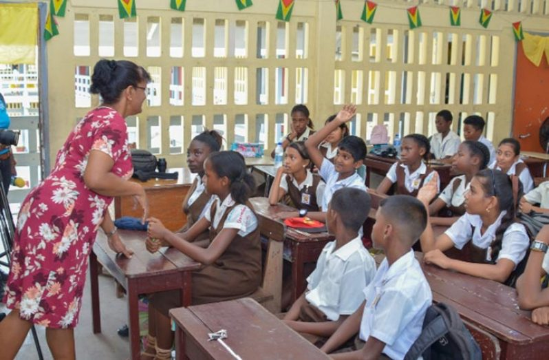 Deputy Headmistress of CV Nunes Primary School, Bindawattie Ketwaru attending to her pupils back in 2019