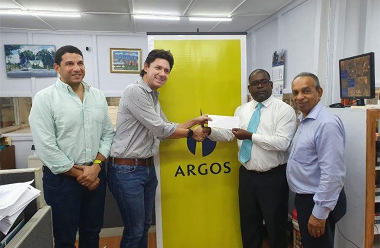 From left, Jose Guillermo Araujo (Marketing Rep Argos), Juan Gonzales (Head of Marketing Argos), Ramesh Persaud (president of Santos FC) and Edward Boyer (CEO of National Hardware).