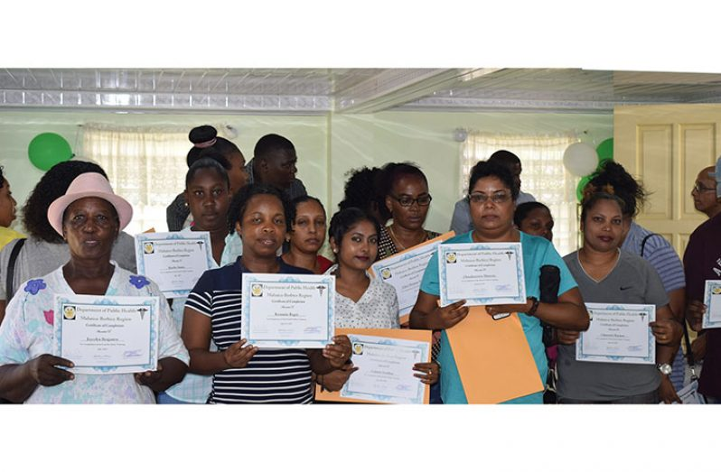 Some of the new food handlers with their certificates during the recent handing over exercise