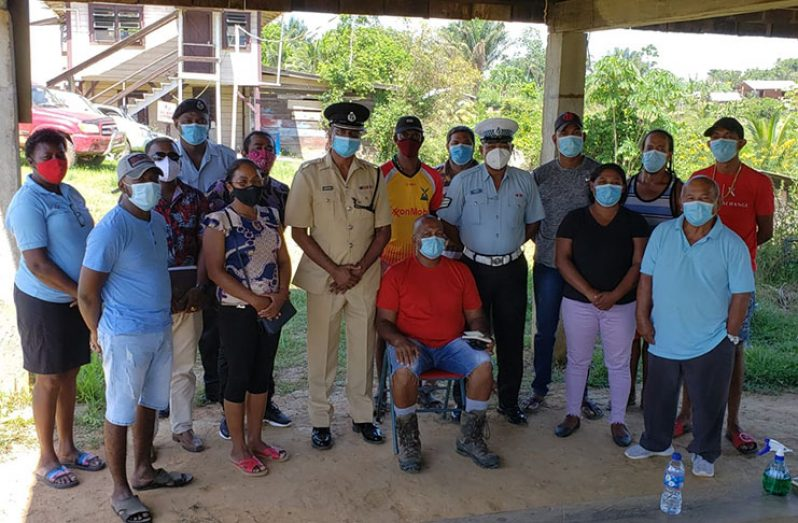 Commander Ramlakhan with the members of the recently-formed Baramita Station Management Committee.