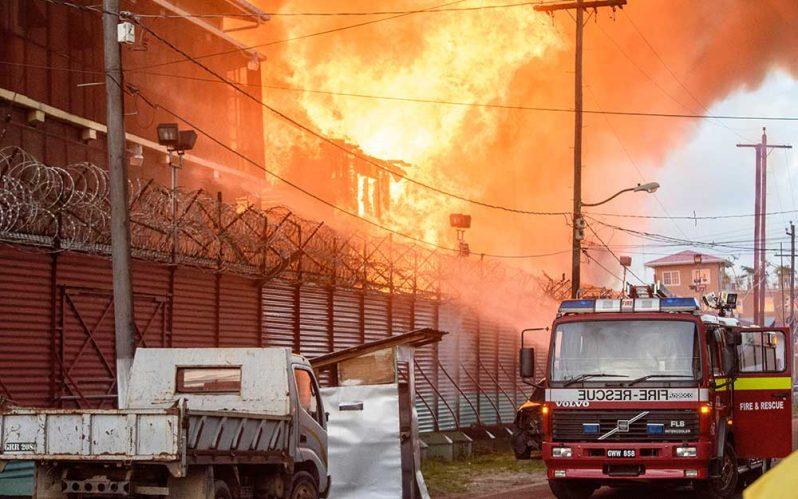 Firefighters battling the blaze at Camp Street Prison on Sunday