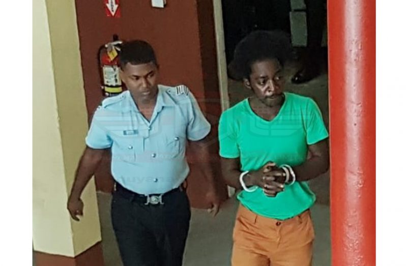 The accused as he was escorted at the Georgetown Magistrates' Court on Tuesday.
